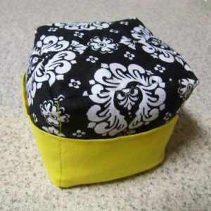 White damask pattern on black background with yellow pocket