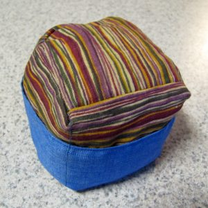 thin, uneven stripes of yellow, green, burgundy, and purple with a blue pocket