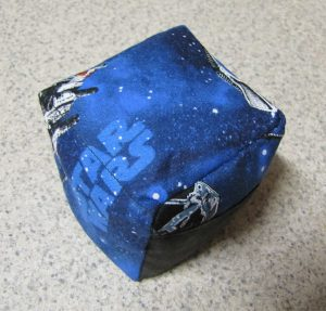 Star Wars patterned fabric with mottled, black pocket.